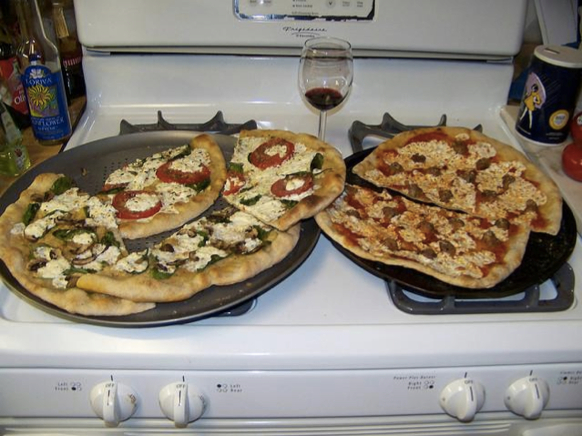 """Two pizzas sitting on top of a stove oven"" / Photo: Google/Oriol Vinyals, Alexander Toshev, Samy Bengio, and Dumitru Erhan"