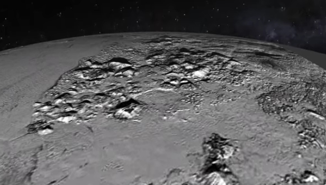A flyover of the Norgay Mountains (center) and Sputnik Plain (appearing on the left) from the New Horizons press conference Friday; Photo: NASA/JHUAPL/SwRI