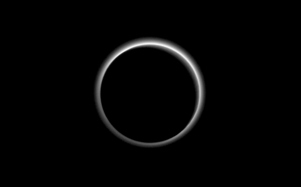 Pluto, backlit; Photo: NASA/JHUAPL/SWRI